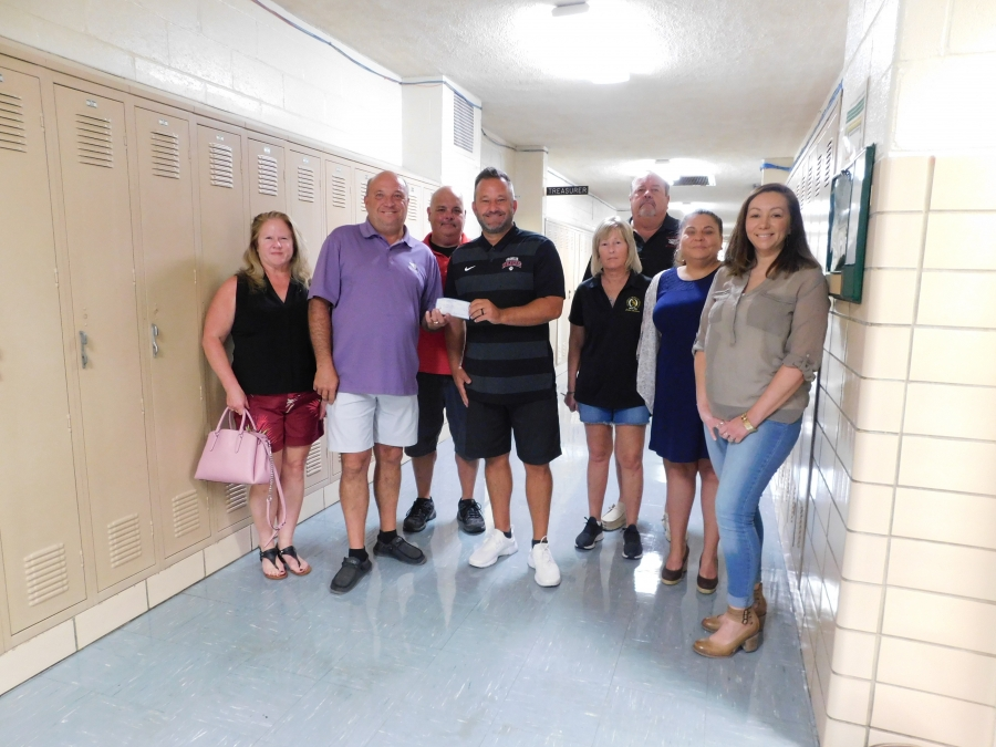 Pictured from left are Susie Estes, Kelly Estes, Chris Isaacs, Brian Bales, Sheila Blevins, Doug Adams, Ashley Land-Back, and Andee Land-Lewis.